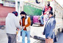 District Administration Kishtwar distributing relief material among needy in Kishtwar. -Excelsior/Tilak Raj