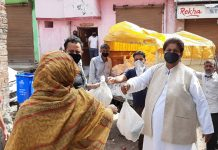 Former Minister Raman Bhalla distributing essential items among needy in Gandhi Nagar Constituency on Thursday.