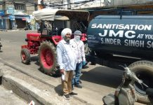 Councillor of Ward Number 44, Inder Singh, handing over his tractor to JMC along with driver and diesel free of cost for purpose of sanitization/fumigation in Jammu city to counter Coronavirus pandemic.