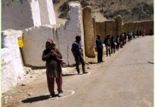 People observing social distancing while getting ration from District Administration Leh at Thiksay.