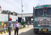 An HPCL officer flagging off a truck of petroleum product for Leh.
