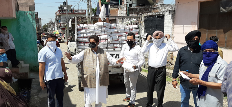 Former Minister and senior Congress leader Raman Bhalla while distributing ration and allied items among needy in Gandhi Nagar Constituency in Jammu.