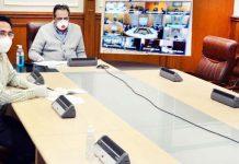 Advisor Baseer Ahmad Khan chairing a meeting at Jammu on Friday.