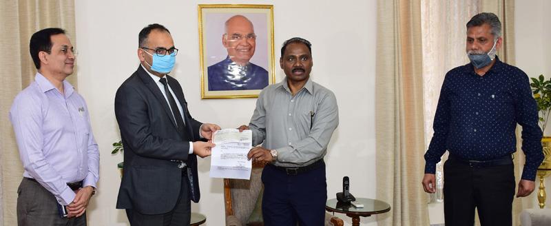 Lieutenant Governor, Girish Chandra Murmu handing over a cheque to Registrar General of HC on Wednesday.
