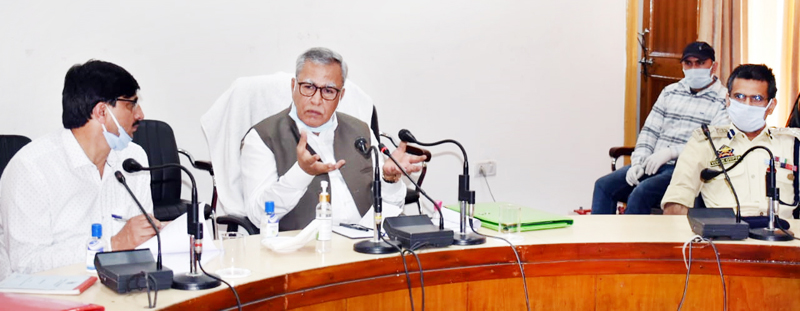 Advisor Farooq Khan chairing a meeting at Rajouri.