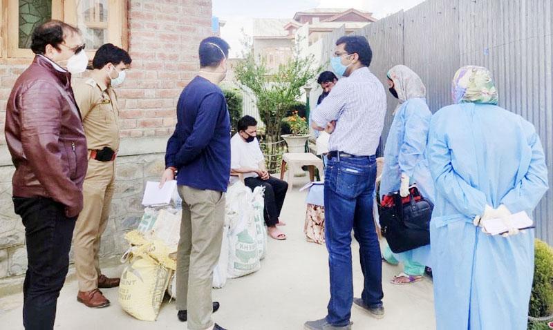 DC Srinagar Shahid Iqbal Choudhary interacting with people during door to door health survey.