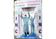 Health professionals passing through Decontamination & Sanitizing Tunnel established at GMC Jammu. -Excelsior/Rakesh