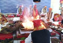 CEO of SMVD Shrine Board and others participating in Shat Chandi Maha Yagya at Mata Vaishno Devi Shrine.