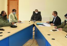 Advisor Umang Narula chairing meeting in Leh on Wednesday.