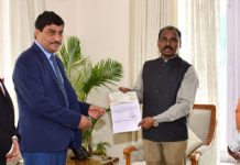 Financial Commissioner, A K Mehta presenting cheque of Rs 2 crore to Lt. Governor as a contribution to J&K Relief Fund.