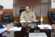 Union Minister Dr Jitendra Singh discussing the conclusions of National Corona Survey conducted across districts in India, with officials in the Union Ministry of Personnel, through video conferencing, at New Delhi on Thursday.