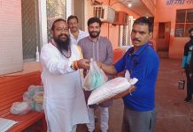 Gaushala Jammu president Raj Kumar Gupta distributing ration among needy people at Gaushala Ambphalla on Wednesday.