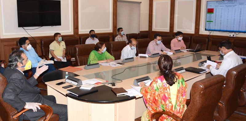 Advisor Baseer Khan chairing a meeting on Thursday.