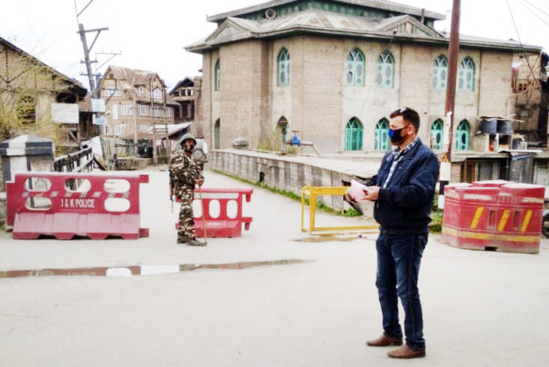 Security personnel at Chattabal area which has been declared as containment zone.