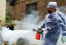 Workers spray disinfectants in a rural area of Bhaderwah on Wednesday. — Excelsior/Tilak Raj