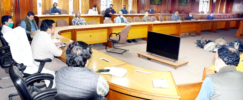 DDC Udhampur chairing a meeting on Monday.