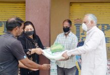 MP Shamsher Singh Manhas handing over ration to needy people.