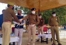 DIG Udhampur-Reasi range Sujit Kumar distributing masks and sanitizers among cops at DPL Udhampur on Tuesday.