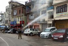 Fire Brigade men spraying disinfectant to prevent spreading of COVID-19 in Jammu.