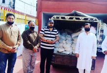 BJP and RSS workers handover truck full of ration for distribution among needy people in Jammu on Thursday.