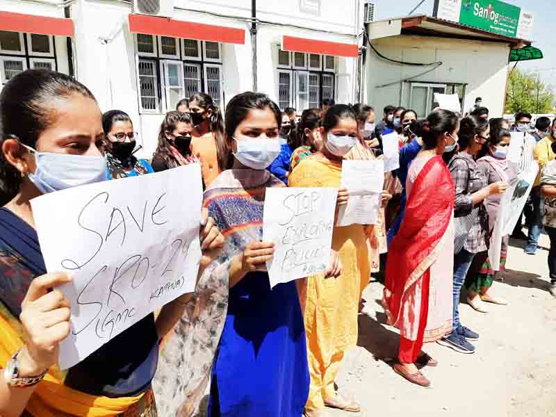 Terminated paramedical staff holding protest in support of their demands at GMC Kathua.