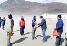 Officials engaged in distribution of food items in Leh.