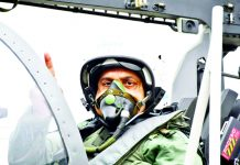 Air Chief Marshal R K S Bhadauria onboard Tejas fighter aircraft before taking a sortie during the 18 Squadron of the Indian Air Force launching ceremony at Sulur Air Force Station near Coimbatore on Wednesday. (UNI)
