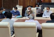 DC Srinagar chairing a meeting on Friday.
