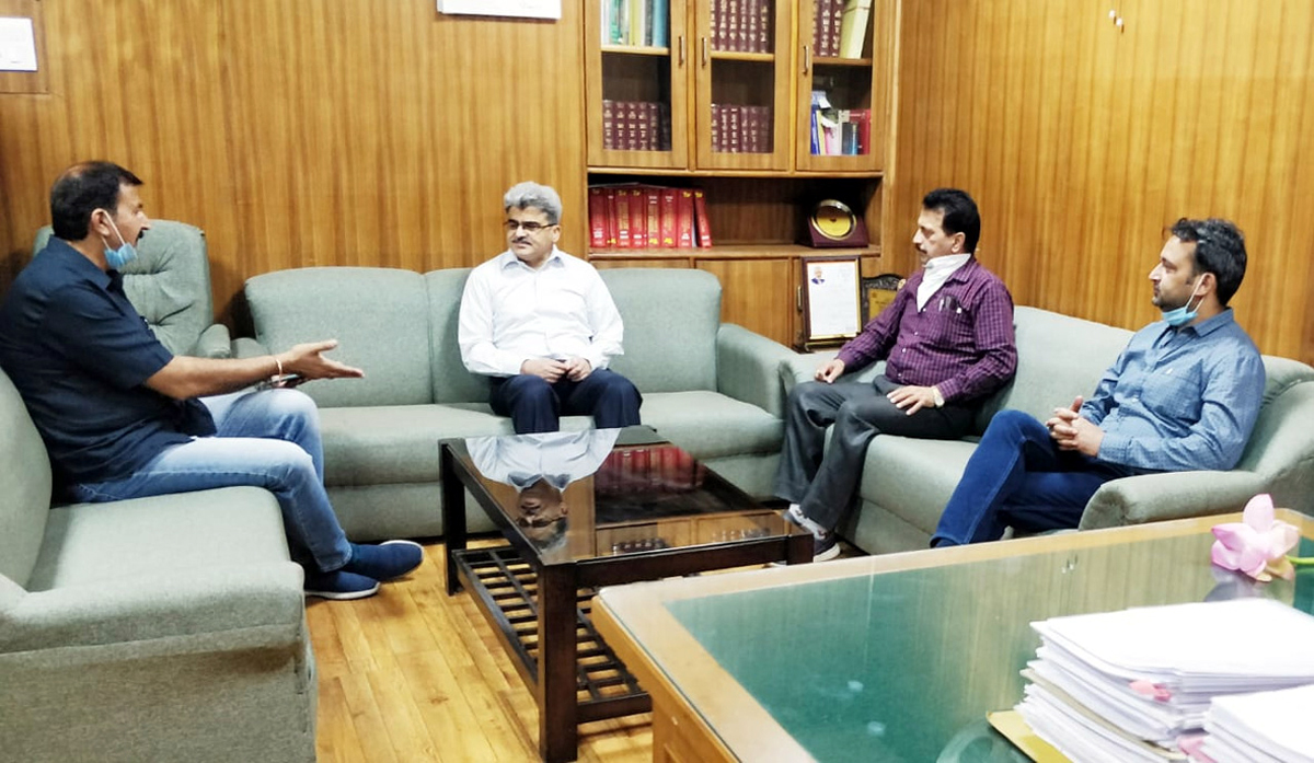 BJP delegation briefing Financial Commissioner Health Atal Dulloo on the condition of quarantine centres in Jammu on Friday.