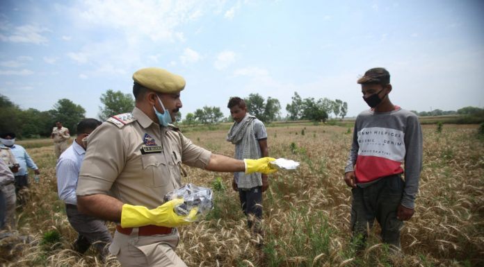 Police officials led by SHO RS Pura Inspector Jai Pal Sharma help the border dwellers on the IB in Jammu sector on Wednesday.