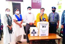 Representatives of Bharat Scouts & Guides presenting masks to needy in Udhampur.