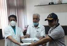 Bharat Sharma, BJYM leader handing over safety kits on behalf of Union Minister, Dr Jitendra Singh to GMC Principal, Dr Naseeb Chand Digra and Medical Superintendent Dr Dara Singh at Jammu on Saturday.