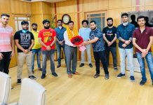 Delegation of youth wing of Mohyal Sabha felicitating J&K Bank CMD, R K Chhibber in Jammu on Friday.