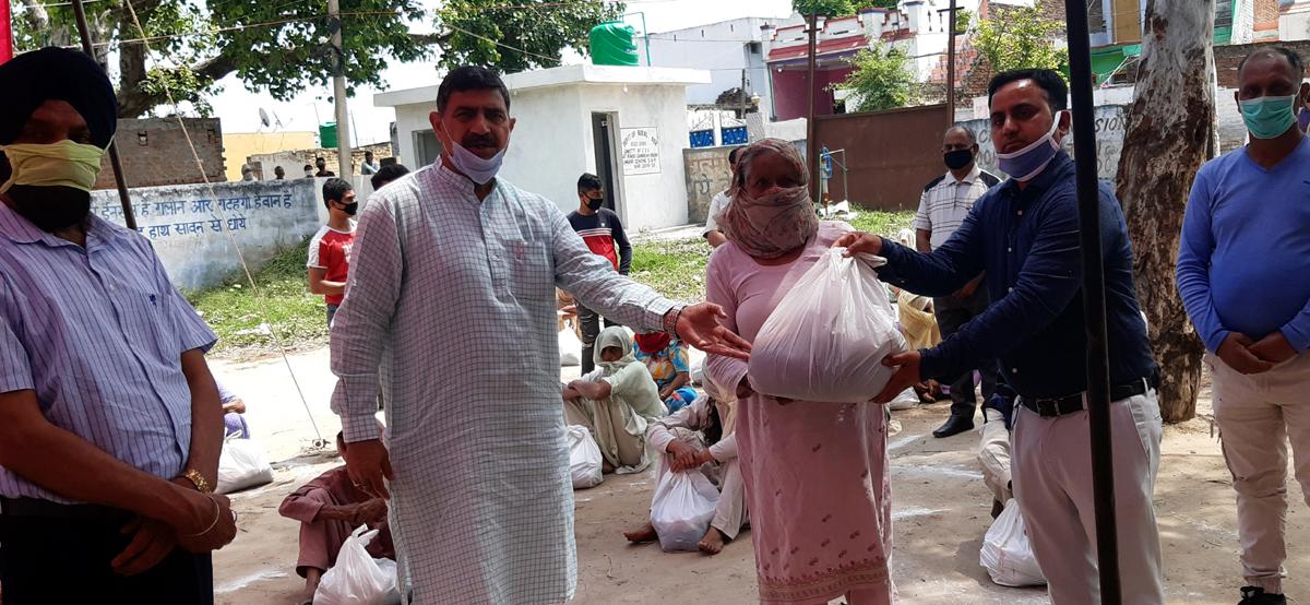 MP Jugal Kishore Sharma distributing ration among needy in R S Pura on Wednesday.