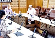 Advisor K K Sharma chairing a meeting at Jammu.