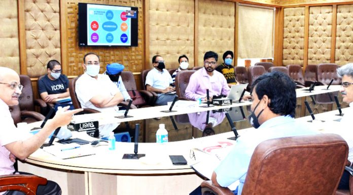 Chief Secretary BVR Subrahmanyam presiding over a meeting in Jammu on Friday.