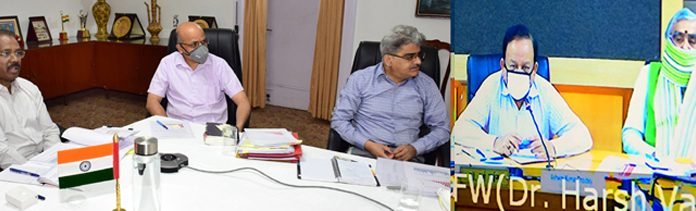 Lieutenant Governor Girish Chandra Murmu in video conference with Union Health Minister Dr Harsh Vardhan on Tuesday.