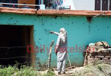 A man points to damage caused to his house in Pakistan shelling at Balakote sector of Poonch district on Tuesday. -Excelsior/Rahi Kapoor