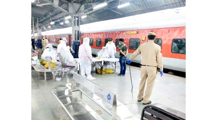 Health workers and police personnel geared up at Railway Station as first train since lockdown reached Jammu on Thursday morning.