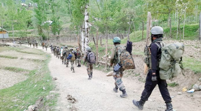 Army moving towards Rajwar forests in Handwara during encounter with militants on Friday. -Excelsior/ Aabid Nabi
