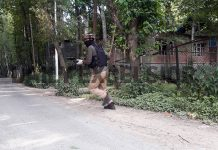 A jawan rushes to the site of encounter in Kulgam on Saturday. -Excelsior/Sajad Dar