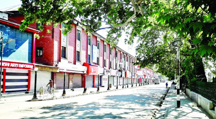 A view of deserted road during lockdown in Srinagar on Friday. -Excelsior/Shakeel