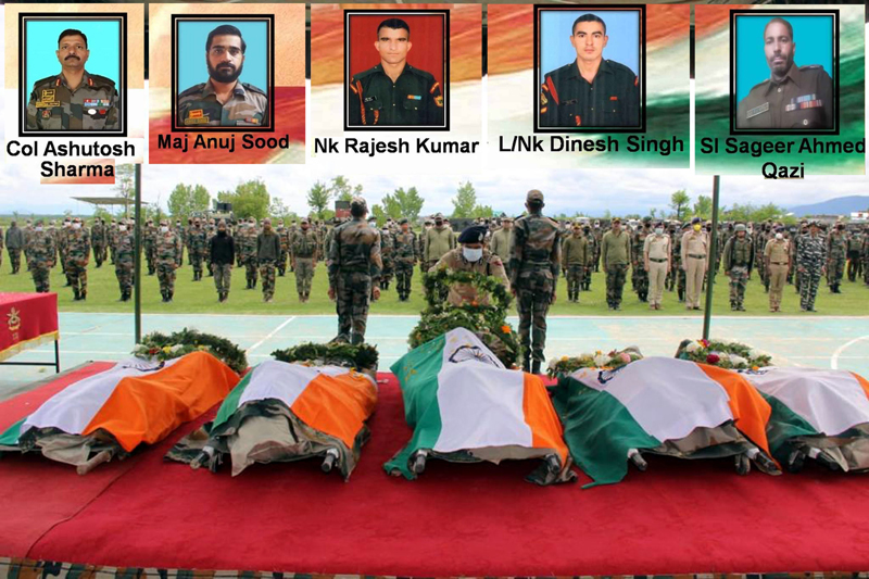 Senior Army and police officers pay tributes to martyrs in Srinagar on Sunday. (UNI)