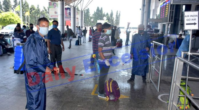 Passengers at Srinagar Airport on Monday. —Excelsior/Shakeel