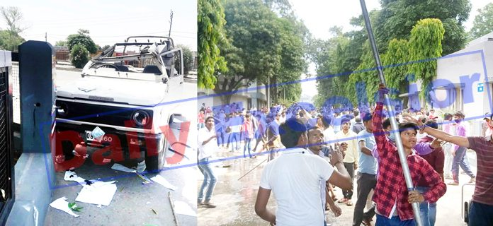 A police Gypsy damaged by mob (left) and agitating workers of CTM on rampage in Kathua (right) on Friday. -Excelsior pics by Pardeep Sharma & Madan Magotra