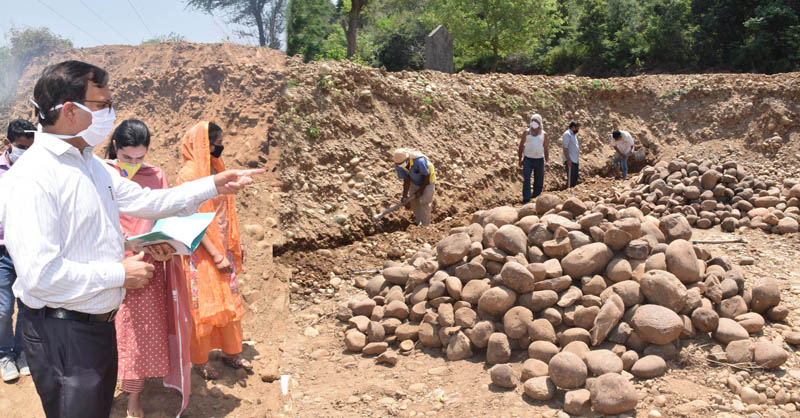 A senior officer monitoring labour activity in Bhalwal as MGNREGA works resume in Jammu on Saturday.
