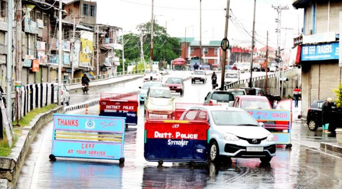 A good number of private vehicles moving on Budshah Chowk road in Srinagar on Thursday.(UNI)