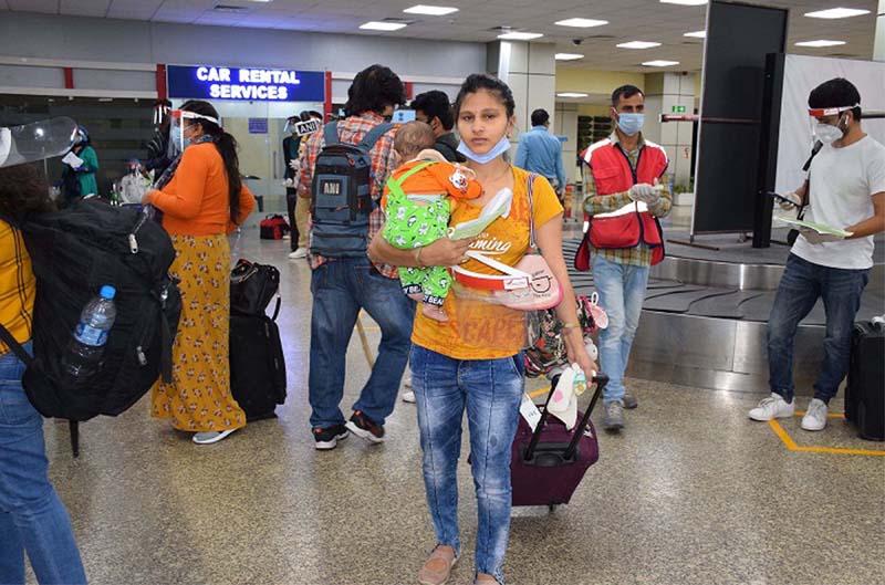 Passengers arrive at Jammu Airport on Monday.