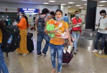 Passengers arrive at Jammu Airport on Monday.