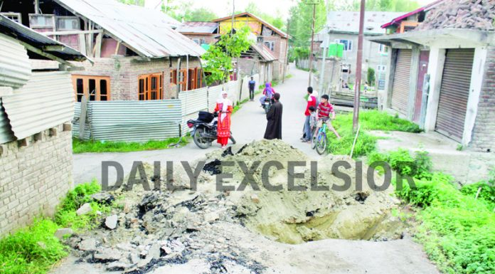 Road dug by people of Reshipora, Kakapora in Pulwama to prevent entry of outsiders on Tuesday. -Excelsior/Younis Khaliq